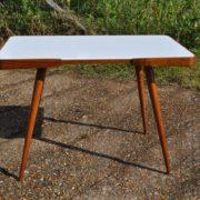 White vitrolite-topped coffee table