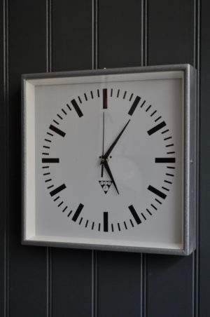 Metal cased clock