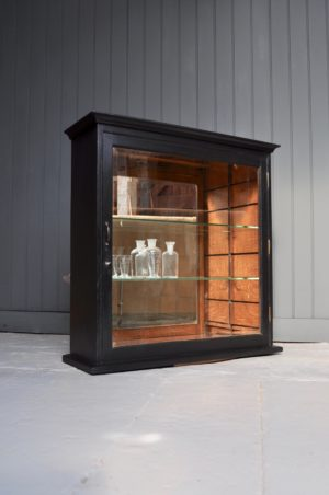 Ebonised glazed cabinet