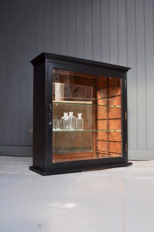 Ebonised glazed cabinet