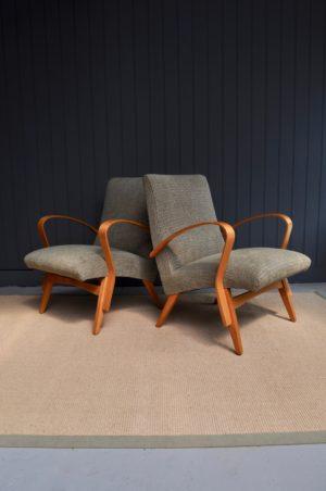 Pair of mid-century rocket tarta chairs