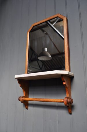 mirror with marble shelf